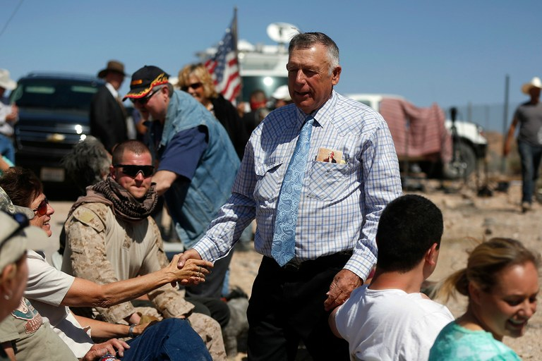Rancher Cliven Bundy greets supporters before a roadside church service at a protest site in Bunkerville, Nev. April 13, 2014, the day before the U.S. Bureau of Land Management called off an effort to round up Bundy's herd of cattle that it had said were illegally grazed for decades, citing concerns about safety.