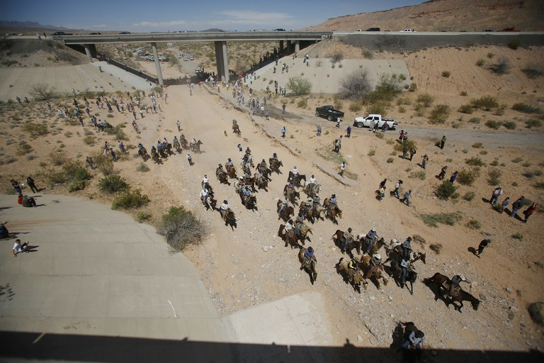 Protesters retreat from the BLM's base camp, where the cattle that were seized from rancher Cliven Bundy are being held. The conflict between Bundy and U.S. land managers had brought a team of armed federal rangers to Nevada to seize the 1,000 head of cattle.