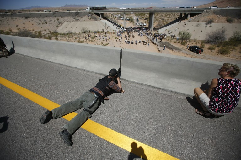 Eric Parker from central Idaho aims his weapon from a bridge as protesters gather by the BLM's base camp, where cattle were being held, April 12. Members of anti-government militia groups from several surrounding states came to Nevada to protest the cattle round-up.
