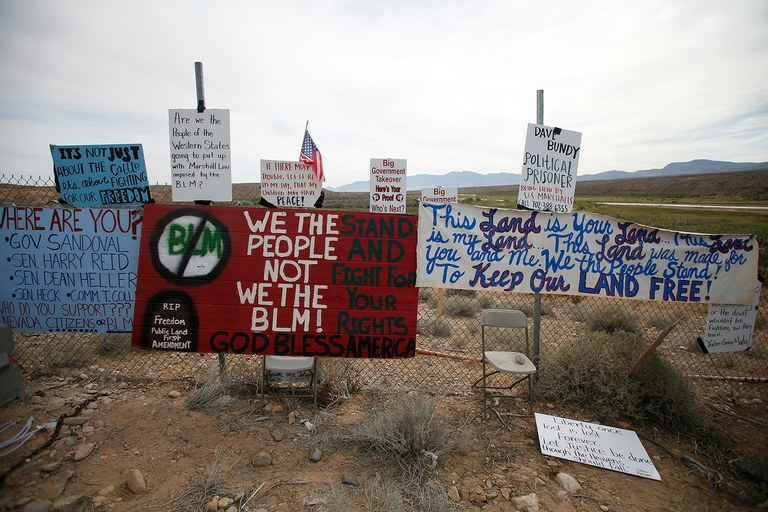 Protest signs on a fence in Bunkerville, Nev., April 11. The recent events are part of a long history of anti-federal government movements in Western states.