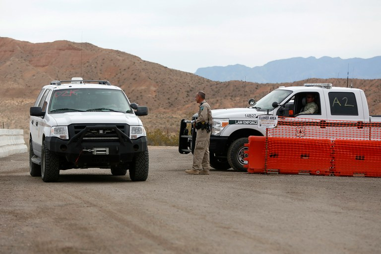 U.S. Rangers man a temporary roadblock in Bunkerville, Nev., April 11, while the BLM rounds up trespass cattle.