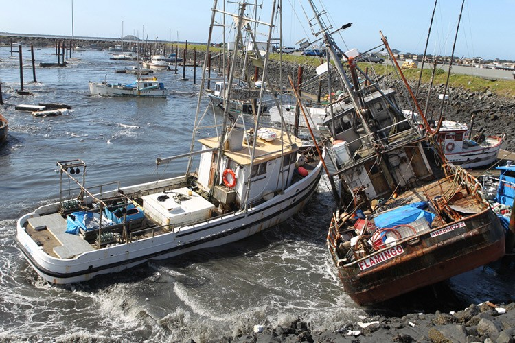 Boats teeter in Crescent City, California's harbor as a tsunami, spurred by an 8.9 earthquake off the coast of Japan, arrives in the early morning of Friday, March 11