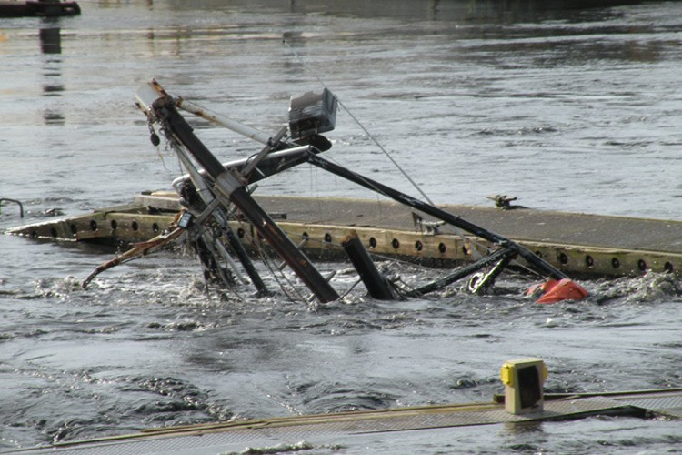 A sunken boat left in the Crescent City harbor, after the tsunami waves hit
