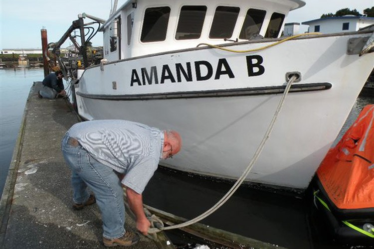 Captain Alan Mello readies his boat for escape