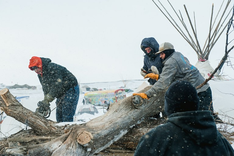 Residents of Eagle Butte, on the Cheyenne River Reservation in South Dakota, unload donated firewood into a campsite at the Oceti Sakowin camp in Cannon Ball, North Dakota on Dec. 7, 2016.