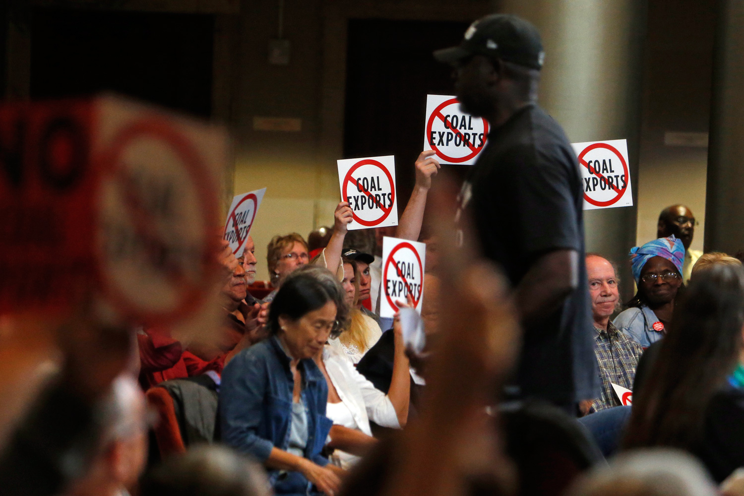Anti-coal protesters react to pro-coal speaker Ronald Mohammad during an  Oakland City Council meeting on June 27, 2016.