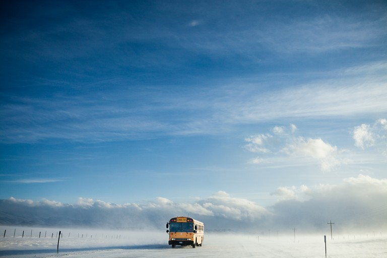 A school bus travels Montana Highway 2 between East Glacier and Browning on the Blackfeet Reservation.