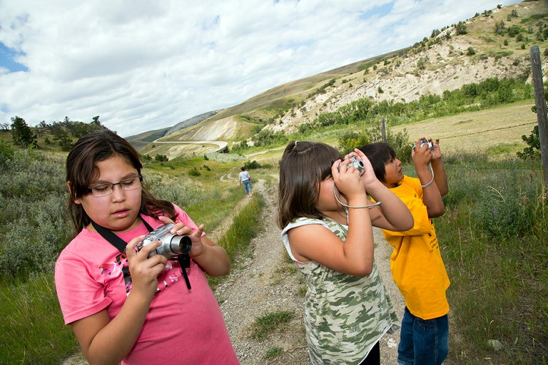 Students on a Boys & Girls Club photography field trip. Heart Butte, Blackfeet Reservation, Montana.