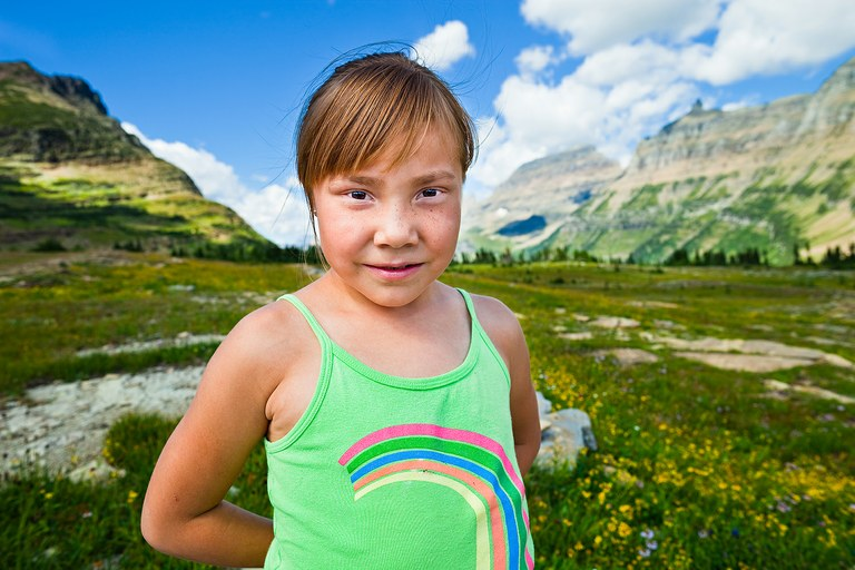 Annie Whitney, 6, stands at Logan Pass on the Going to the Sun Highway during a field trip to Glacier National Park with the Browning Boys & Girls Club.  Before it became a national park, this land belonged to the Blackfeet Tribe.
