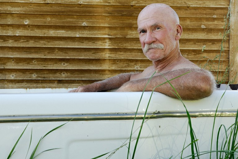 The author, bathing outside his cabin