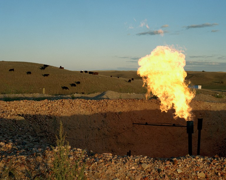 Natural gas flare, White Earth River Valley, September 2013. Approximately 30% of the natural gas in North Dakota is being flared off. It is cheaper for companies to flare the gas