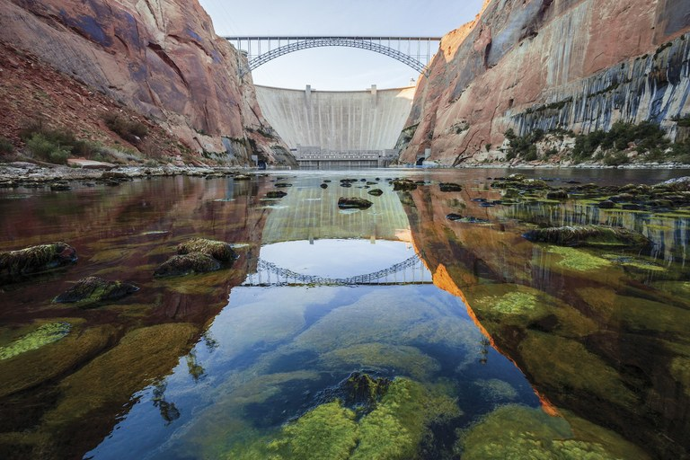 Extremely cold water trickles out of the Glen Canyon Dam into what's left of Glen Canyon, forming an unnatural stretch of trout water on the Arizona/Utah border in a scene from DAMNATION.