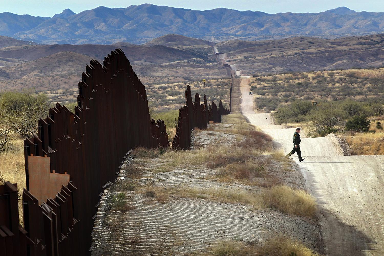 Veteran photographer shines light on us immigration photographer john