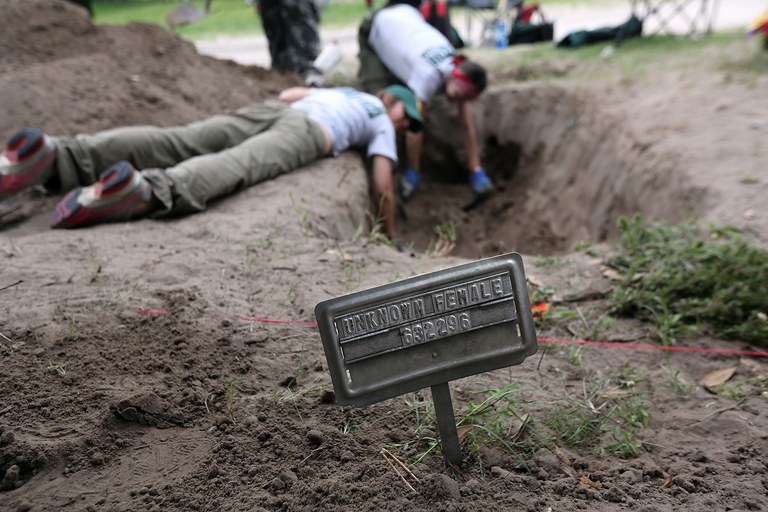 A forensic anthropology team from Baylor University unearths the remains of unidentified immigrants from a cemetery in May 2013 in Falfurrias, Texas. Teams from Baylor University and the University of Indianapolis exhume the bodies of more than 50 immigrants who died, mostly from heat exhaustion, while crossing illegally from Mexico into the U.S. The bodies will be examined and cross-checked with DNA sent from Mexico and Central American countries, with the goal of reuniting the remains with families.
