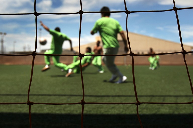 Newly arrived detainees play a game of soccer at the U.S. Immigration and Customs Enforcement (ICE) detention facility for illegal immigrants in July 2010 in Florence, Arizona. Most immigrants at the center are awaiting deportation or removal and will eventually return to their home countries. Others are interned at the facility while their immigration cases are being reviewed.
