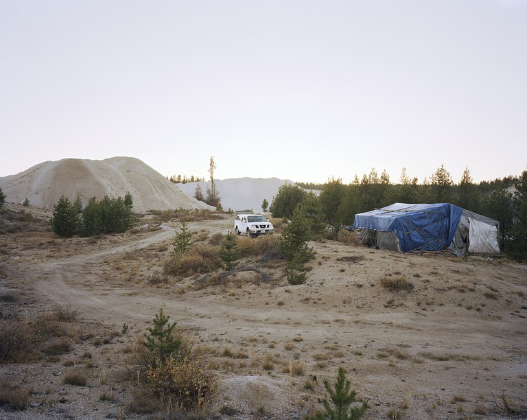 SUV and shack at a mushroom camp near the Sierra Cascade Pumice Mine, Oregon, 2011.