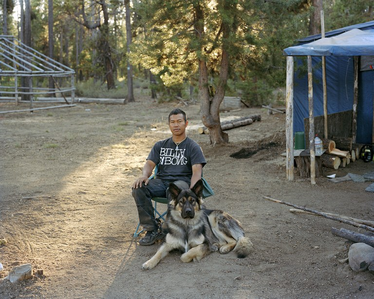 Somphone with his dog Whiskey outside their shack in the Crescent Lake mushroom camp, Oregon, 2011.