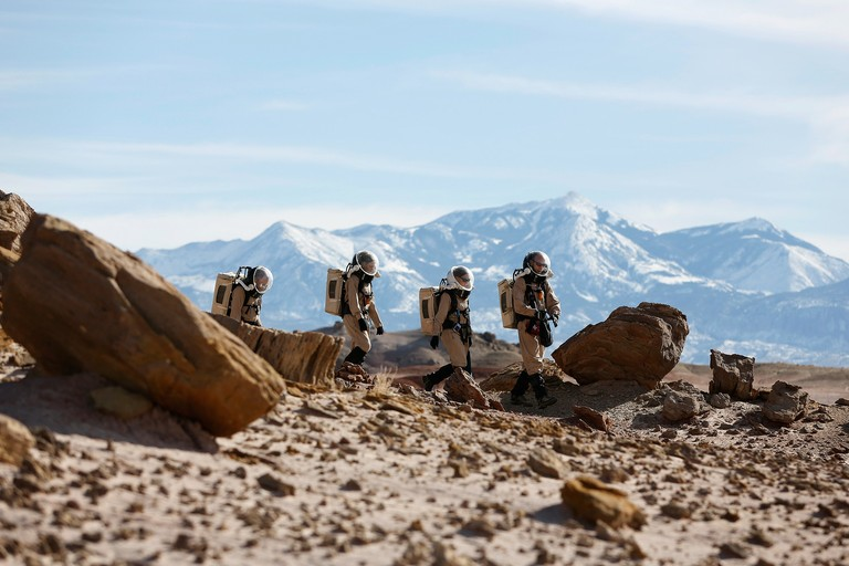 "Researchers venture out in their spacesuits to collect geologic samples. ""It is one thing to walk around a factory test area in a new spacesuit prototype and show that a wearer can pick up a wrench—it is entirely another to subject that same suit to two months of real field work,"" declares the MDRS website."