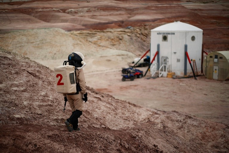 Geologist Csilla Orgel makes her way back to the Mars Desert Research Station after a field excursion.