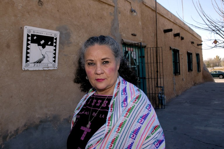 Denise Chávez poses outside the Cultural Center de Mesilla, an adobe brick building that she said was built in the 1840s, in Mesilla, N.M, on Wednesday, Nov. 30, 2005.