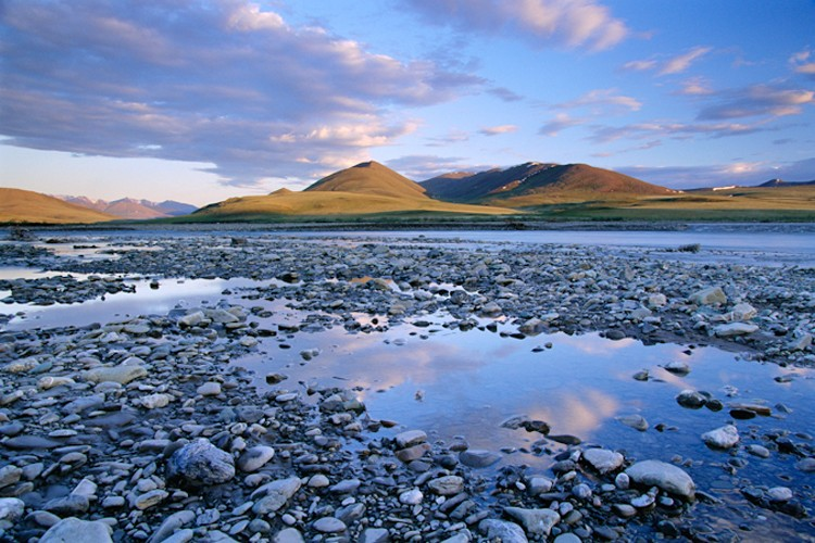 The Kongakut River is one of the major rivers originating in Alaska's Brooks Range, coursing through the refuge and ending in the Beaufort Sea.  This image was taken at Caribou Pass in the Arctic National Wildlife Refuge while on a backpacking trip.
