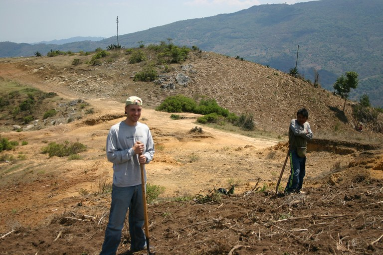 Author Seth Holmes planting corn with a Triqui teenager in the mountains of Oaxaca, while conducting research for his new book.