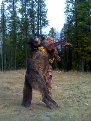 hunter with dead wolf