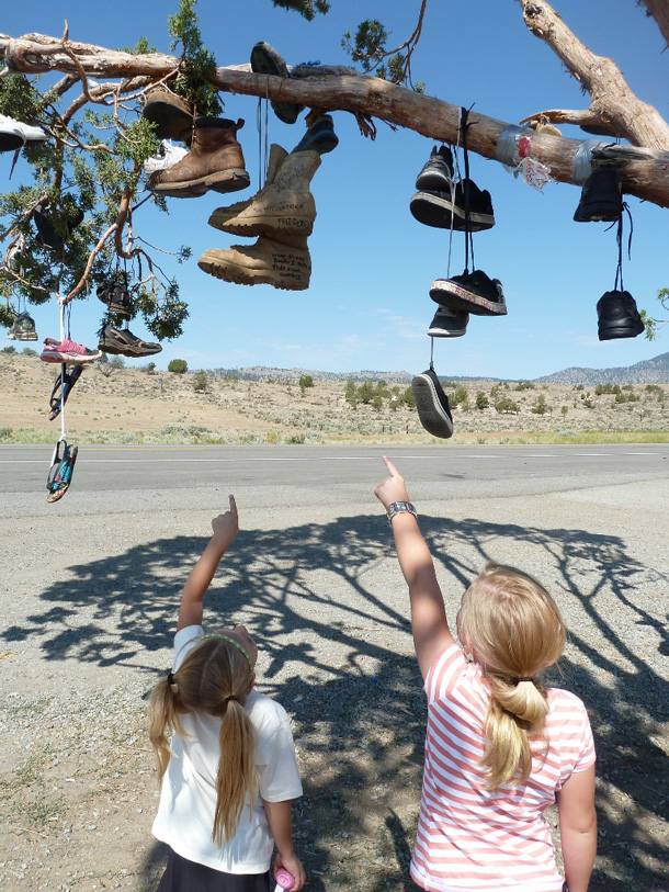 Girls pointing at shoe tree