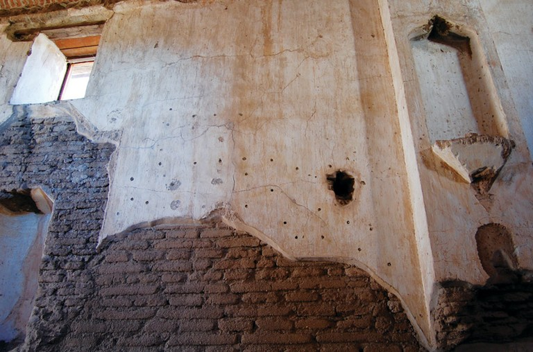 Restoration gone bad at Tumacácori, where holes were drilled for rebar in an attempt to keep the plaster in place.