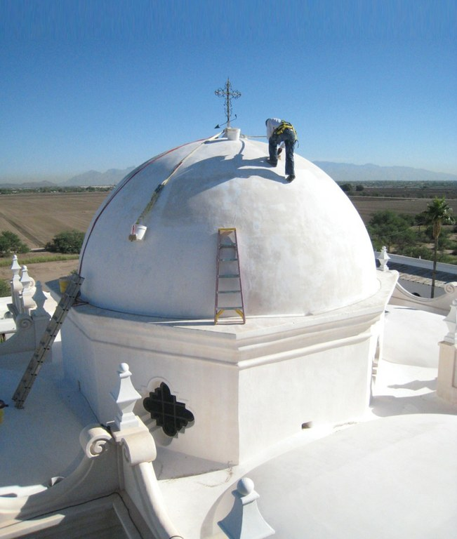 A workman on the dome of the San Xavier del Bac mission in the desert near Tucson.