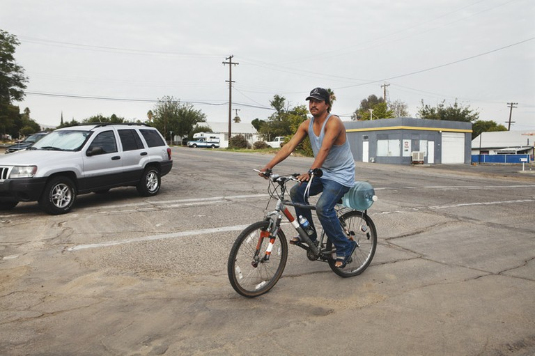 A man hauls water in Taft, California.