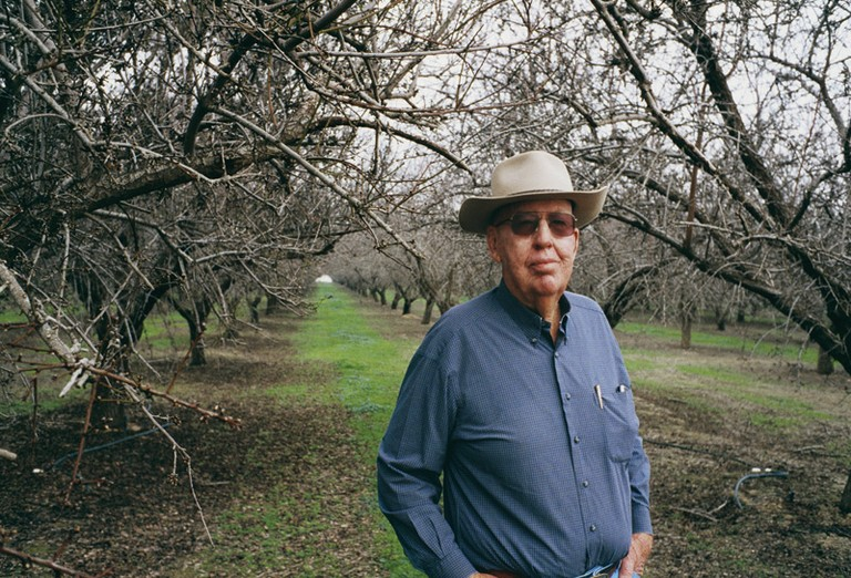 Fred Starrh in his Kern County almond orchard. He recently was awarded $8.5 million in a lawsuit over water pollution from neighboring Aera Energy. But he says he needs $2 billion to fully rehabilitate his land.