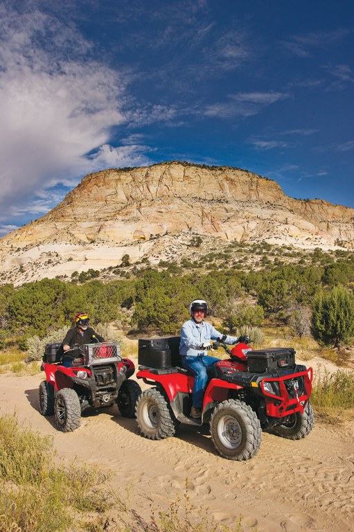 Bryce Nuckols, left, and Ray Wells ride the Nephi Pasture Road in the Grand Staircase-Escalante National Monument, where more than 550 miles of trails are designated for ATVs