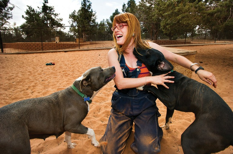 At the Best Friends Animal Sanctuary, near Kanab, Utah, Keeley Floyd with Giah and Nikon.