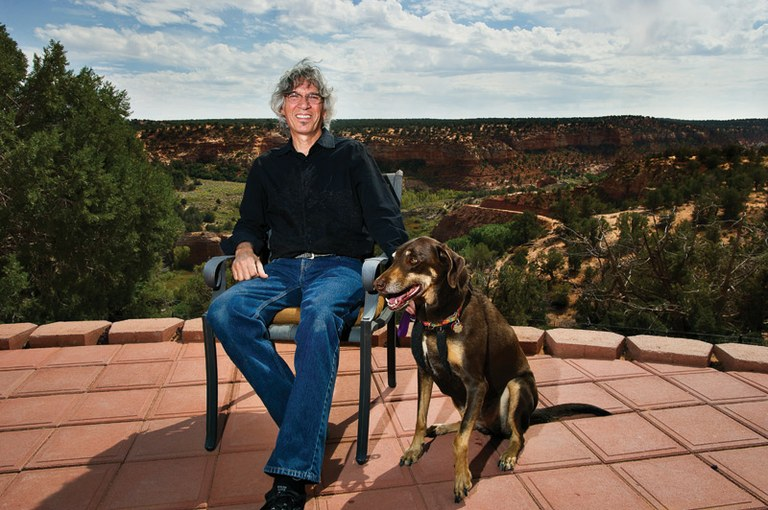 Cyrus Mejia, one of the founders of Best Friends, with Roxy, a rescued Doberman.