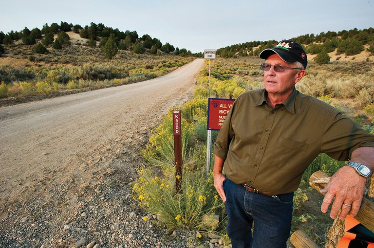 Utah State Rep. Mike Noel stands near a fresh Kane County road marker on Skutumpah Road -- Kane County's first RS 2477 victory -- on the western edge of the Grand Staircase-Escalante National Monument.