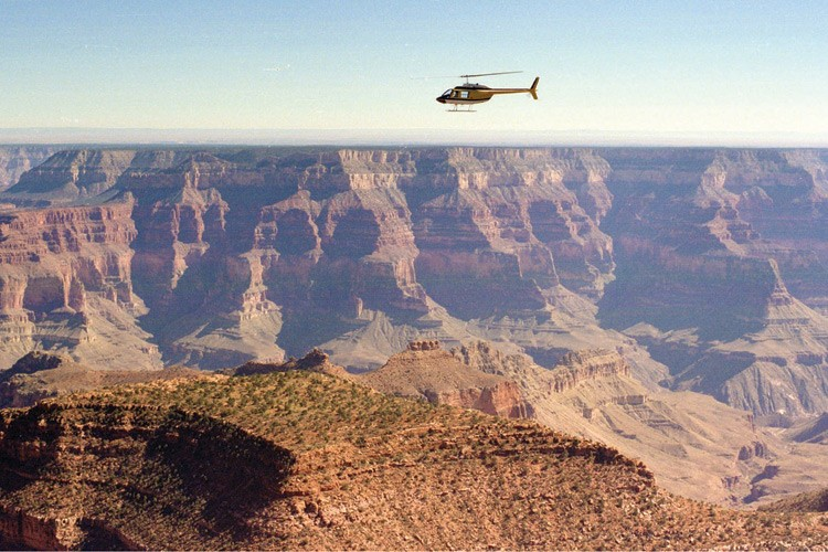 Helicopter flies low over the Grand Canyon.