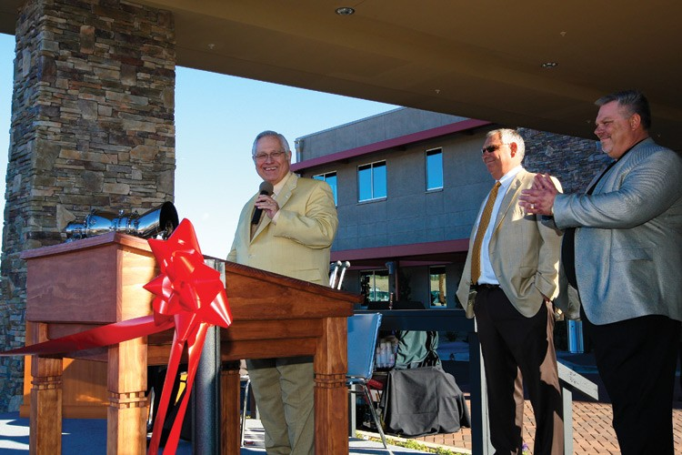 Elling Halvorson gets a standing ovation, including from sons Lon and Kent Halvorson, standing, at the opening of the new $9 million Papillon Airways terminal in Boulder City, Nevada, in 2009. The terminal is the home base of Papillon's aerial sightseeing business.