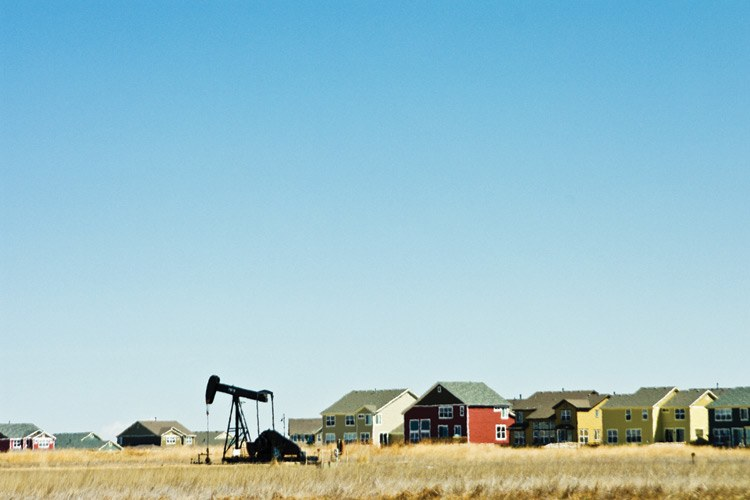 A pumpjack next to homes in Niwot, Colorado, April 2009.