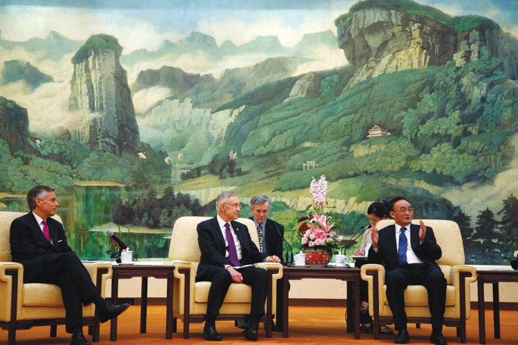 U.S. Sen. Harry Reid (center), Democrat from Nevada, and Republican Jon Huntsman (far left), former Utah governor and now candidate for president, meet with Wu Bangguo, chairman of the Standing Committee of the National People's Congress, during a mission to China in April. Nine other U.S. senators traveled to China for talks on topics from clean energy to human rights.