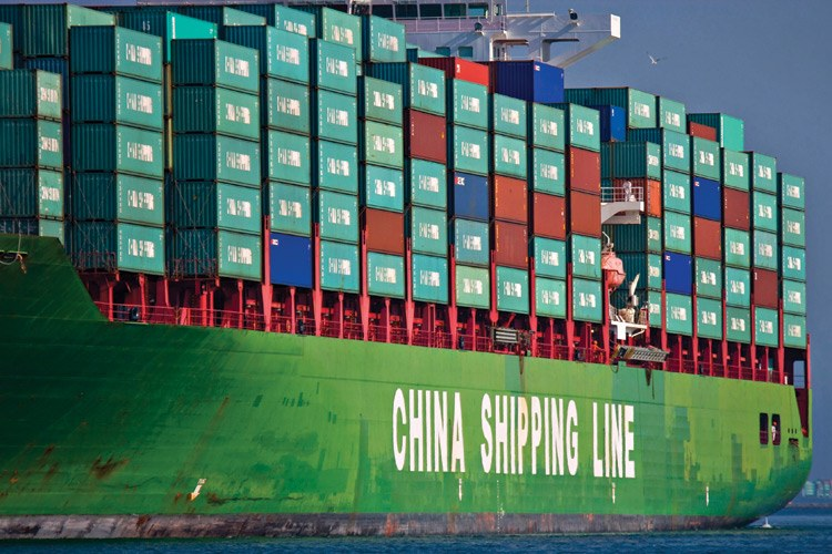 A loaded China Shipping Line container ship makes its way down the main channel at the Port of Los Angeles.