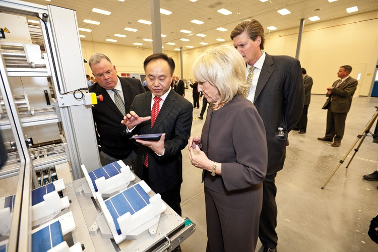 Arizona Gov. Jan Brewer, R, gets an explanation of photovoltaic cells from Suntech founder Zhengrong Shi at Suntech's new manufacturing plant in Goodyear, Arizona.