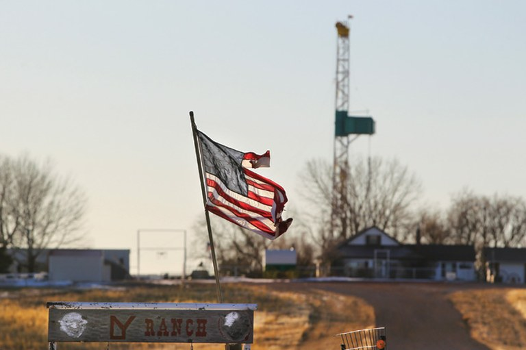 An American flag flaps in the wind on a ranch near Douglas, Wyoming. The area is part of the Niobrara Shale Formation in which the Chinese are invested.