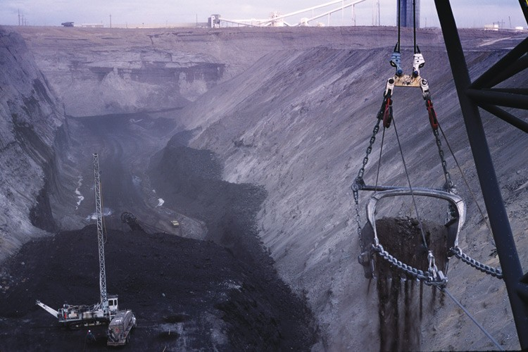 A dragline works at the Black Thunder Mine in Wyoming's Powder River Basin. The mine produces 65 million tons of coal per year, with an ever-larger portion expected to go to Asia.