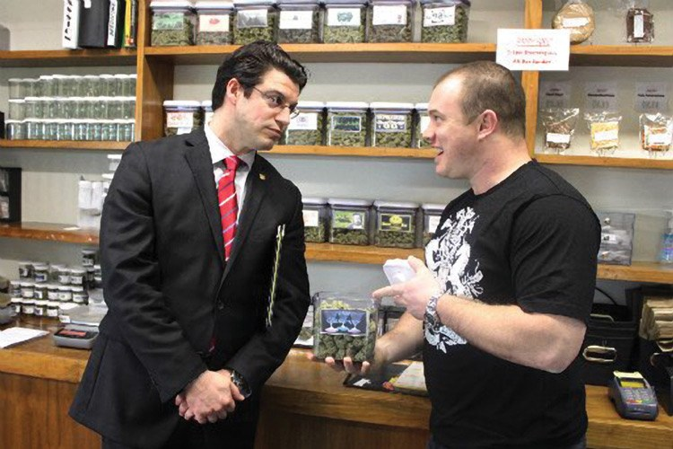 Cannabis lobbyist Max Del Real visits with Caleb Counts at his Sacramento dispensary. Del Real has been retained by the Humboldt Growers Association to push a plan to regulate and tax marijuana -- and to protect market share and the Humboldt name.