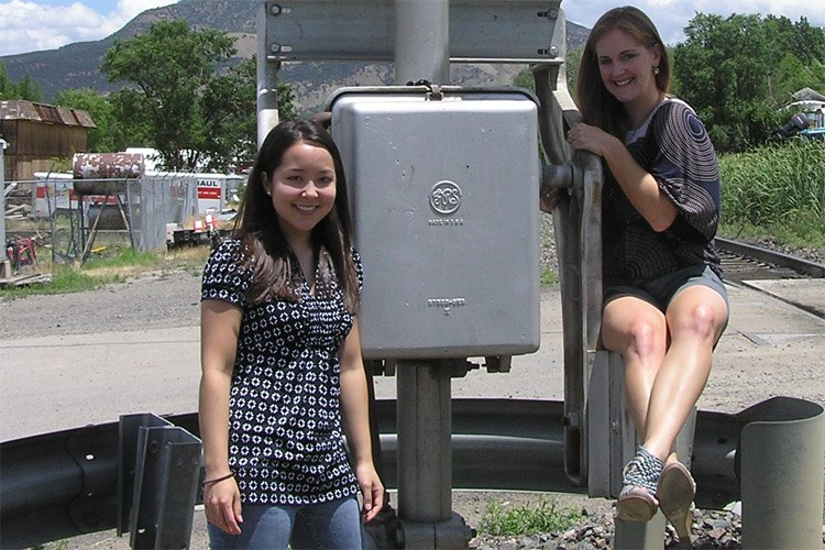 HCN's new interns, Kimberly Hirai and  Marian Lyman Kirst, safely having fun at a train crossing.