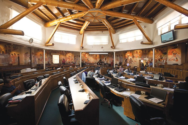 Most of the plush chairs in the Navajo Council Chamber are empty, since a 2009 ballot initiative reduced the number of delegates from 88 to 24