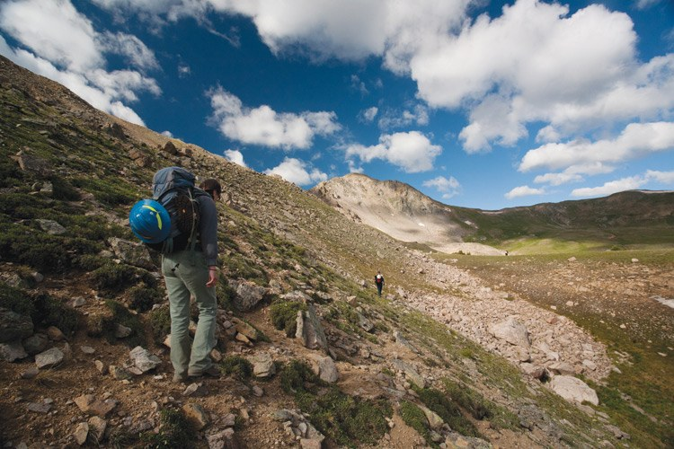 U.S. Forest Service biologist Kelly Larkin hikes into the Colorado high country,  in search of  boreal toads.