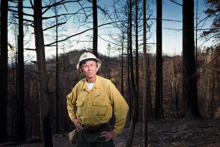 Santa Fe National Forest Fuels Specialist Program Manager Bill Armstrong in an area affected by the L