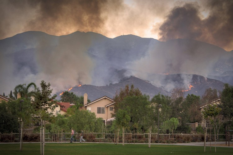 Houses in danger from California's Santiago fire, in 2007